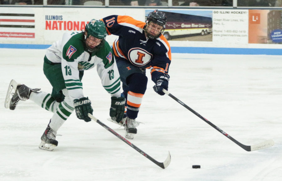 Illinois' Josh Belmont (10) and Ohio's Joe Breslin (13) battle for control of the puck during the CSCHL Playoffs semi-finals v. Ohio University at the Ice Arena on Saturday, Feb. 21, 2015. Illinois lost 3-5.