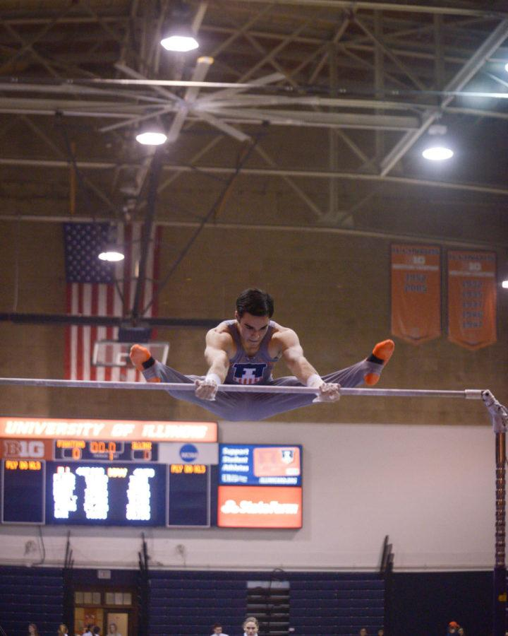 Illinois' Jordan Valdez performs a routine on the high bar against Iowa at Huff Hall on Saturday. The Illini won 440.150-424.500.