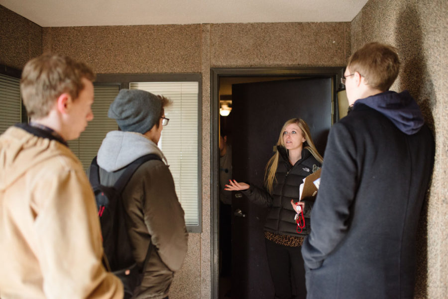 Jackie Koller, leasing coordinator at Bankier Apartments, shows juniors Thomas Lawless, College of Media, John Hadley, LAS, and Ryan Schaffer, major: animal sciences, a property located on Green Street.