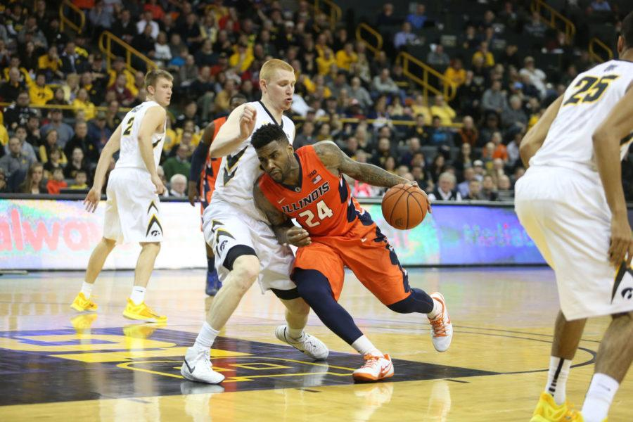 Illinois%27+Rayvonte+Rice+attempts+to+get+past+Iowa%27s+defense+during+the+game+at+Carver-Hawkeye+Arena+in+Iowa+City%2C+Iowa+on+Wednesday.