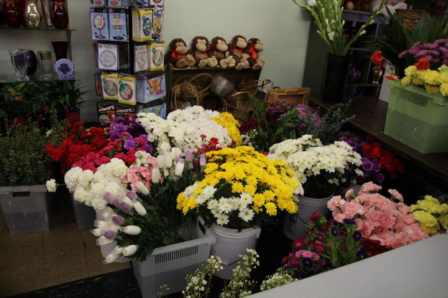 Buckets of flowers for Valentine's Day arrangements fill Campus Florist, located at 609 E. Green St. in Champaign.