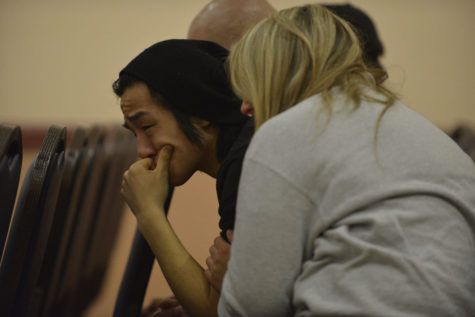 Family hosts vigil for missing UI student