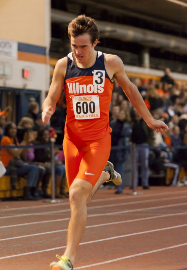 Daily Illini Joe McAsey (600) crosses the finish line in the 1 Mile Event during the Orange and Blue Open at the Armory on Saturday Feb. 4, 2012.