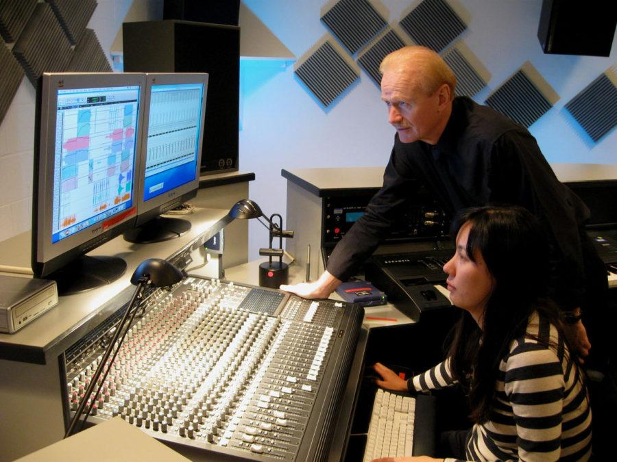 Professor Scott Wyatt, director of the Experimental Music Studios, assists Juri Seo, Doctor of Musical Arts graduate, with using the music software in Studio D in 2013.