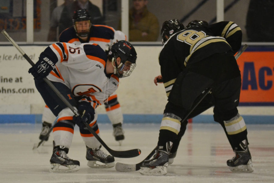 Eric Cruikshank (15) faces off against Tobias Nasgarde (8) of Lindenwood during the game on February 7, 2015. The Illini lost 4-2.