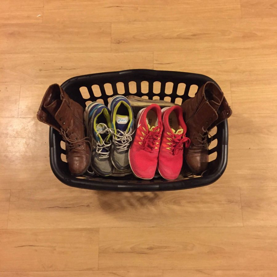 Eliminating shoe clutter is easy with a simple laundry basket to hold the shoes.