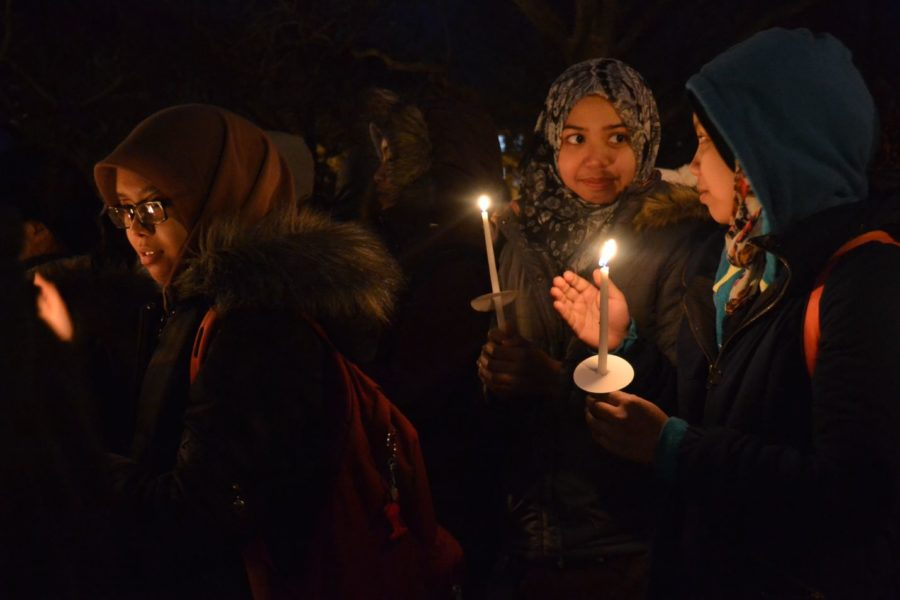 Students gather to show their support at a vigil Friday on the Quad honoring the three murdered Muslim students from the University of North Carolina at Chapel Hill.