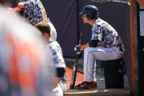 "Illinois' Casey Fletcher waits for his turn at bat during the game against Michigan State ""I felt like we had all the momentum after tying it in the ninth,"" Fletcher said of Illinois' tie on Sunday to Florida Gulf Coast."