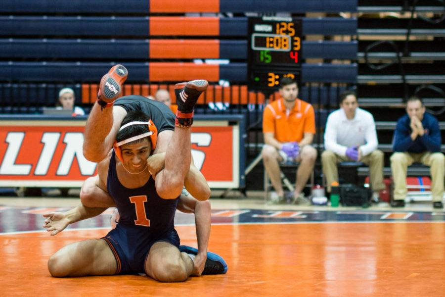 Illinois' Jesse Degaldo makes a move against his opponent during the opening match of the season against SIUE at Huff Hall on Sunday, Nov. 9. The Illini won 44-0