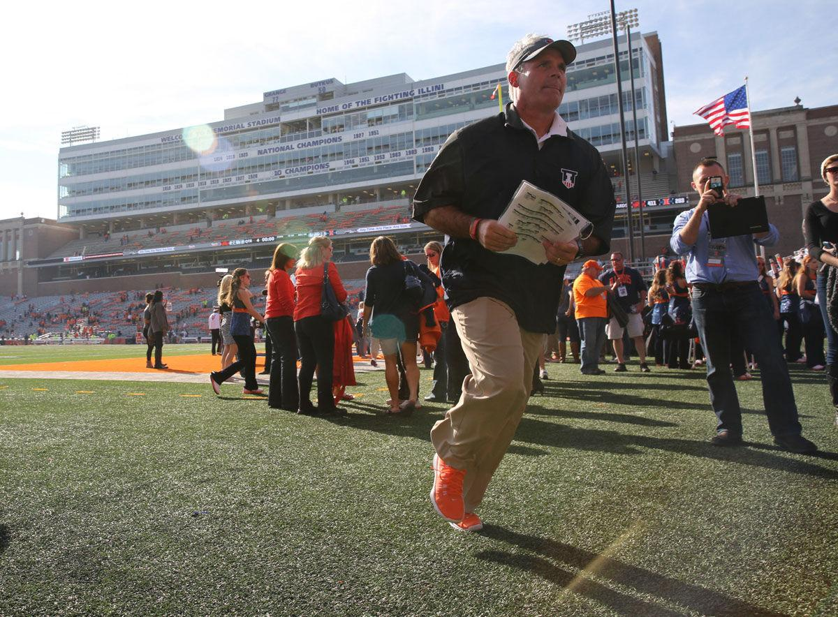 Illinois' head coach Tim Beckman runs towards the locker room after the homecoming game against Minnesota at Memorial Stadium on Saturday, Oct. 25, 2014. The Illini won 28-24.