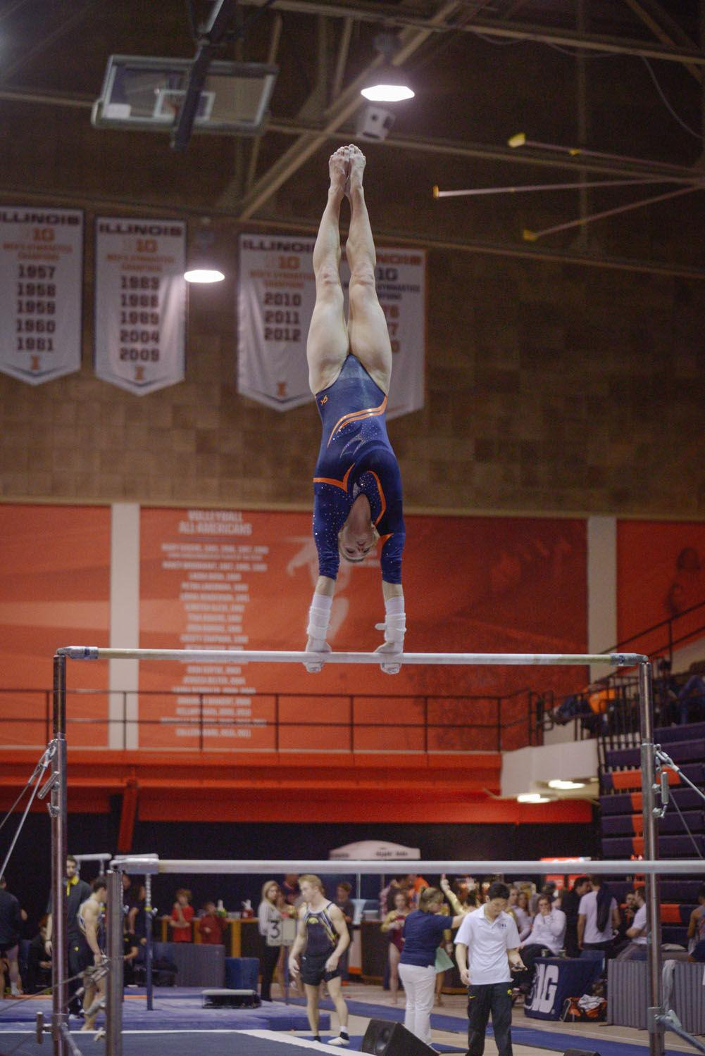 Illinois' Mary Jane Horth performs a routine on the uneven parallel bars during the meet against Minnesota on Saturday.