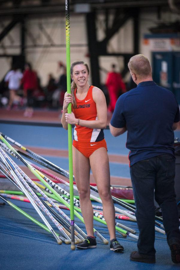 Illinois' Stephanie Richartz smiles as she acknowledges her record-breaking pole vault height of 4.38 meters at the Armory on Saturday, February 21, 2015. The Illini came in first with 216 points, followed by Northern Illinois with 122.