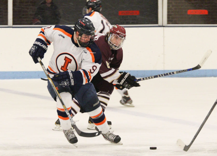 """Illinois' Jacob Matysiak attempts to control the puck during the hockey game vs. Robert Morris on Jan. 24. The Illini got off to an icy start on Friday due to the Bobcats' smaller rink. """"It did affect us because it was a much quicker game,"""" Matysiak said."""