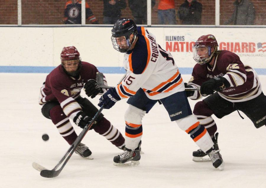 Illinois' Eric Cruickshank attempts to maintain control as Robert Morris put the pressure on Jan. 24. If the Illini wants to beat Ohio, they will need to clean up their game, according to head coach Nick Fabbrini.