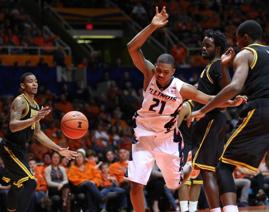 Illinois' Malcolm Hill draws a foul during the game against Kennesaw State at State Farm Center on Dec. 27. Hill has been a strong asset to the team in the midst of injuries and suspensions, averaging 14.6 points per game.