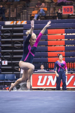 Illinois' Jordan Naleway performs a routine on the floor during the match against Penn State at Huff Hall on Saturday, February 1, 2015.