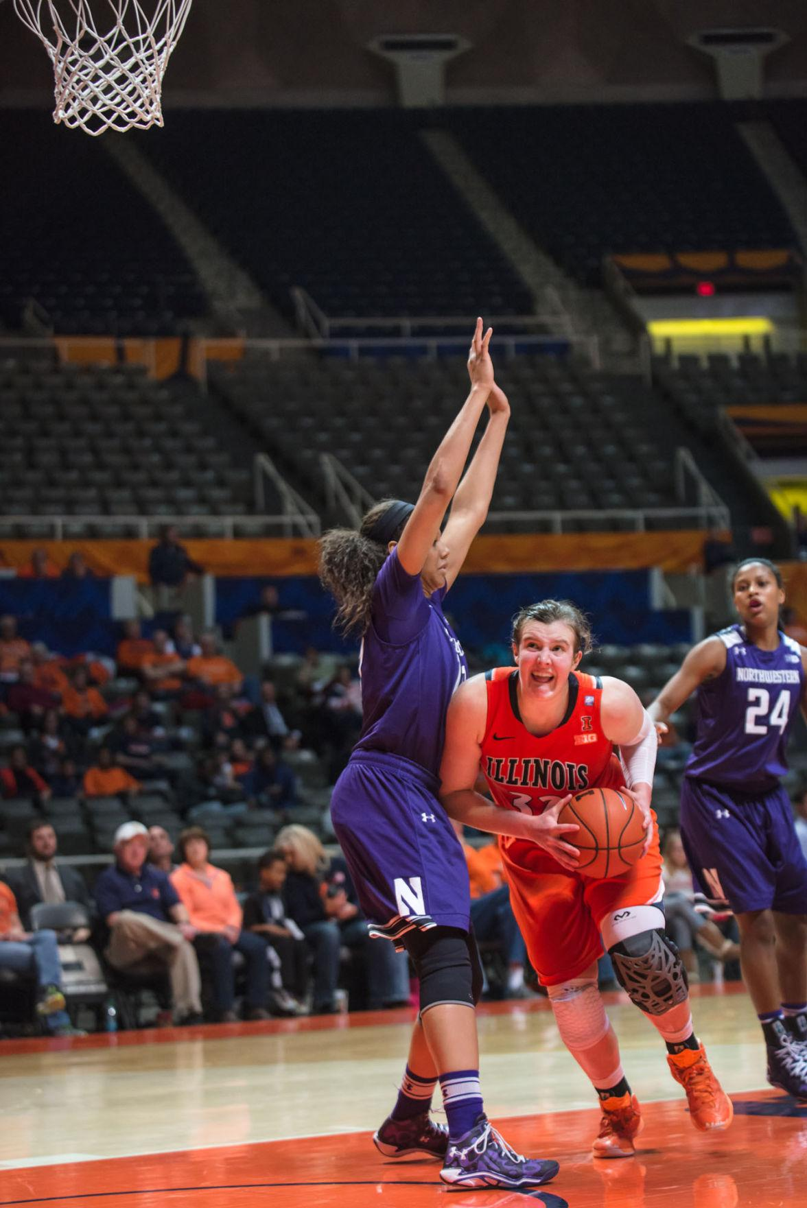 Illinois' Chatrice White (32) tries to edge past her opponent during the game versus Northwestern at the State Farm Center on Thursday, January 22, 2015.