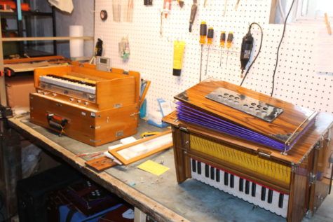 Every instrument Nic Dillon purchases for resale goes through an extensive checklist of repairs. Two harmoniums sit on his work bench before he begins fine tuning and fixing.