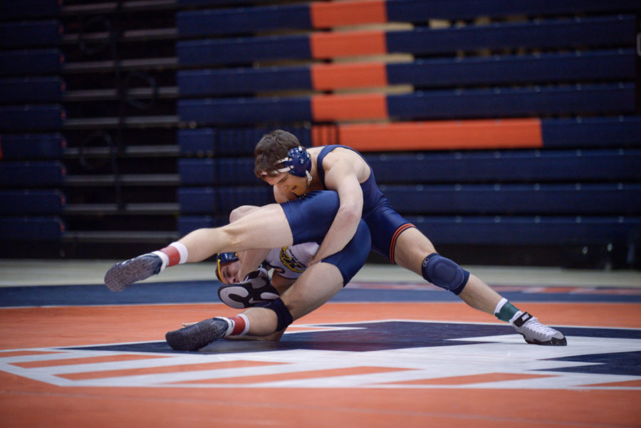 Illinois' Jackson Morse grapples Kent State's Tyler Buckwalter on the mat during the match at Huff Hall on Feb. 15. The Illini are currently preparing for the Big Ten Tournament.
