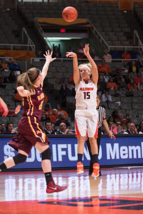 Illinois' Kyley Simmons goes for a three-pointer against Minnesota at the State Farm Center on Thursday, Feb. 5.The Illini struggle on offense despite strong shooting from the arc.