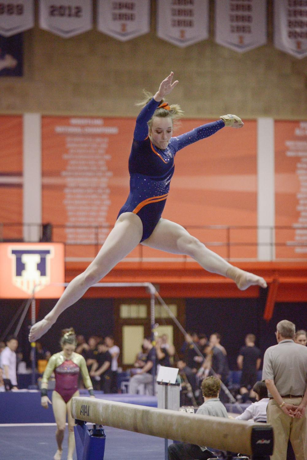 Illinois' Becca Cuppy performs a routine on the balance beam against Minnesota at Huff Hall on Feb. 7. Cuppy is in her first semester at Illinois after graduating high school early.