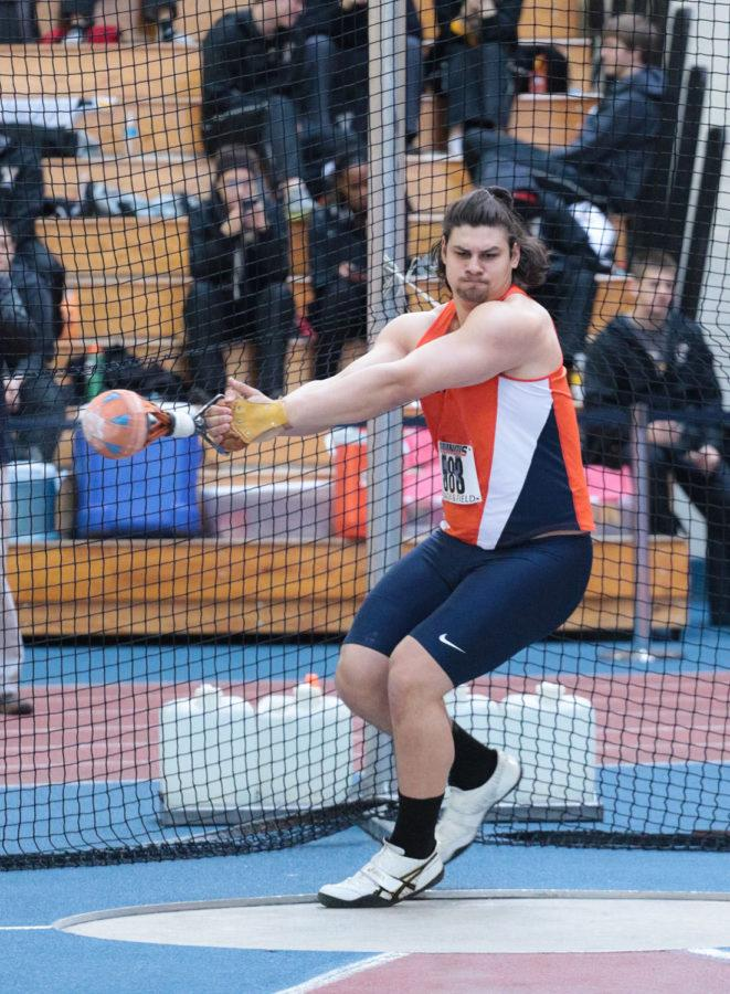 Illinois' Matsen Dziedzic winds up for the throw during the weight throw event at the Orange and Blue meet on Saturday