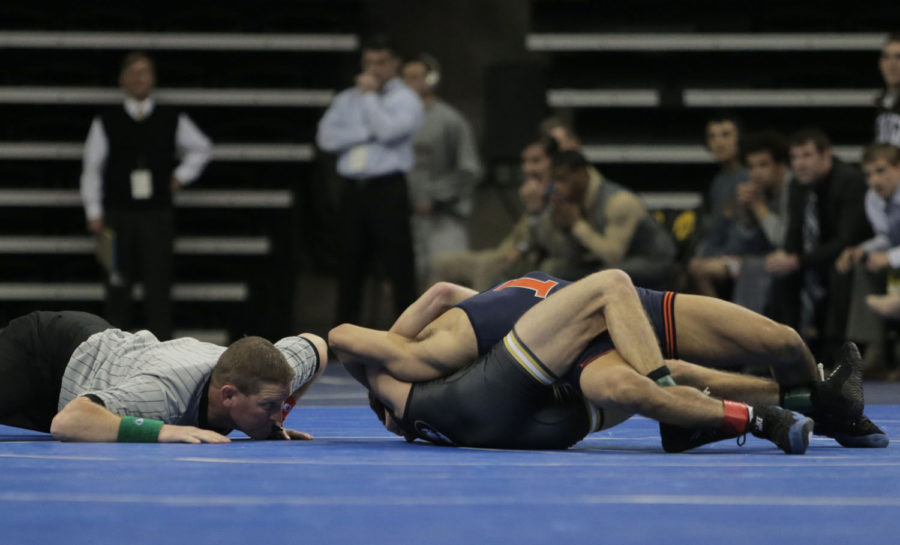 Missouri's Alan Waters tries to pin Illinois' Jesse Delgado during the quarterfinals of the NCWA National Duals in Carver-Hawkeye Arena on Saturday. Waters won, 6-2.