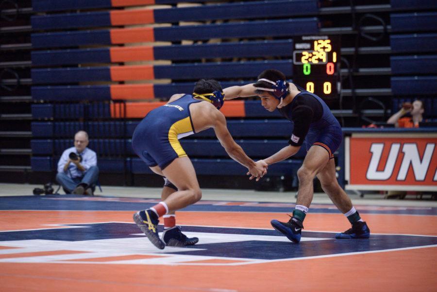 Illinois%27+Jesse+Delgado+locks+arms+with+Kent+State%27s+Edilberto+Vinas+during+the+match+at+Huff+Hall+on+Sunday.+The+Illini+won+38-0.