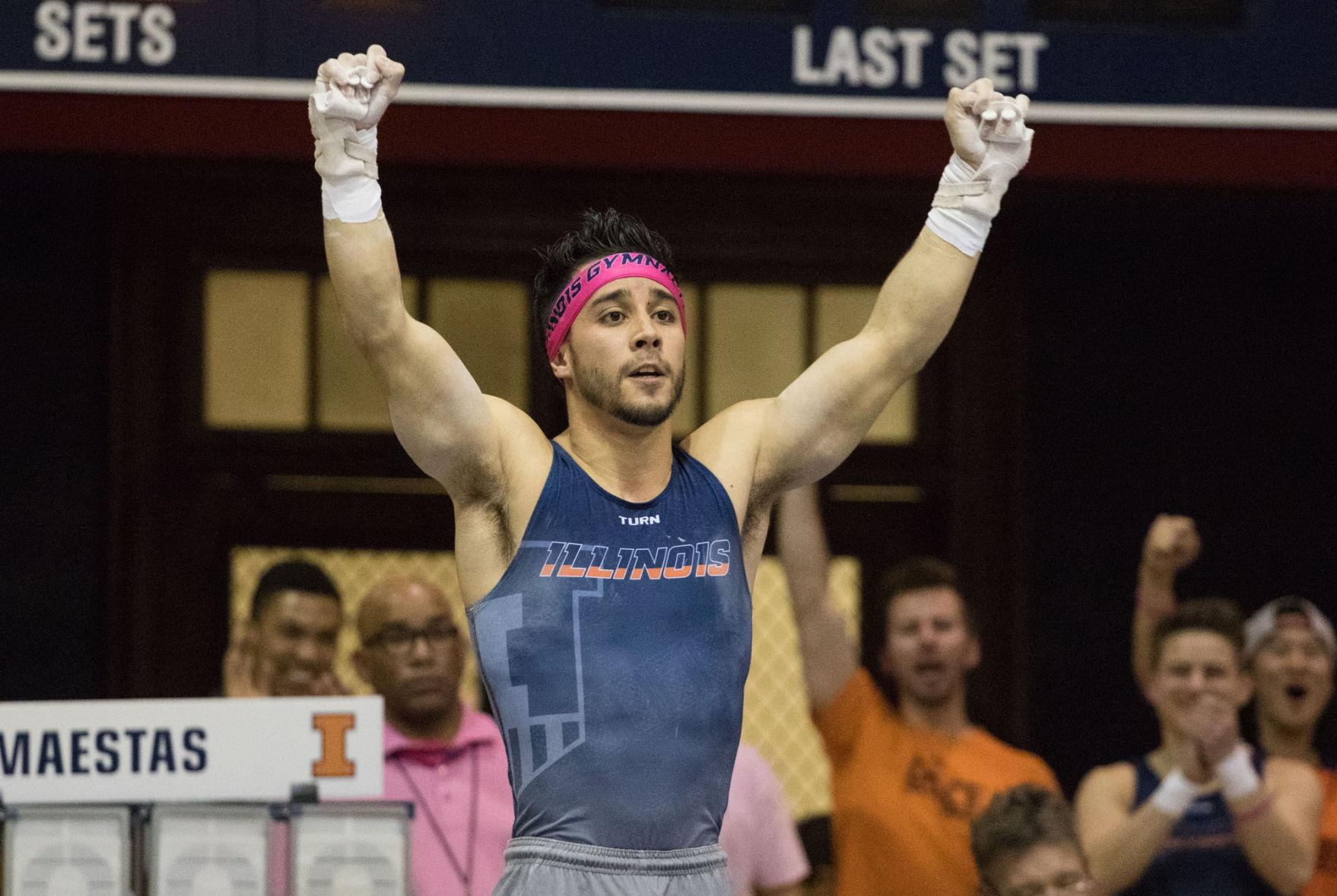 Illinois' C.J. Maestas sticks his landing during the rings event at the gymnastics match vs. Minnesota at Huff Hall on Saturday. Illinois won 435.200-419.800.