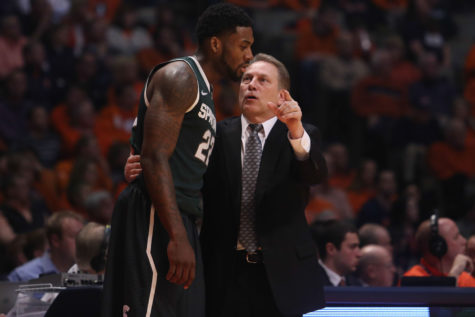 Spartans coach Tom Izzy talking to Brandon Dawson during last season's Illinois-Michigan State game at State Farm Center