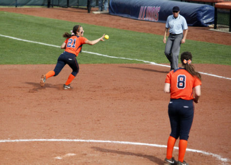 Illinois' Allie Bauch (21) makes a backhanded throw to first base during the second game against Michigan at Eichelberger Field on Saturday April 26. The Illini lost 6-5.