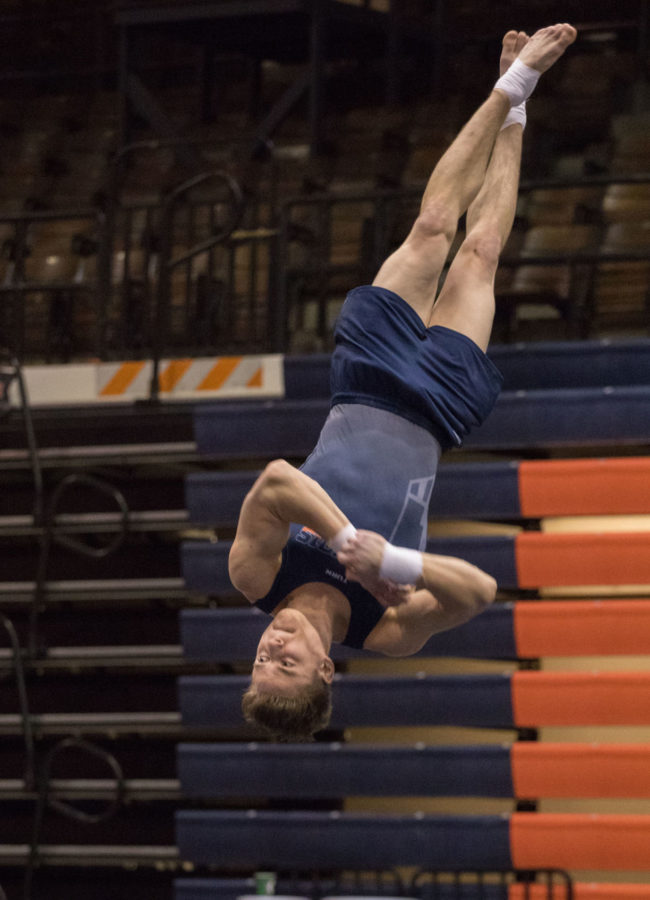 Illinois' Bobby Baker performs his routine during the floor exercise event at the gymnastics match v. Penn State at Huff Hall on Saturday, Feb. 14, 2015. Illinois won 441.300-434.500.