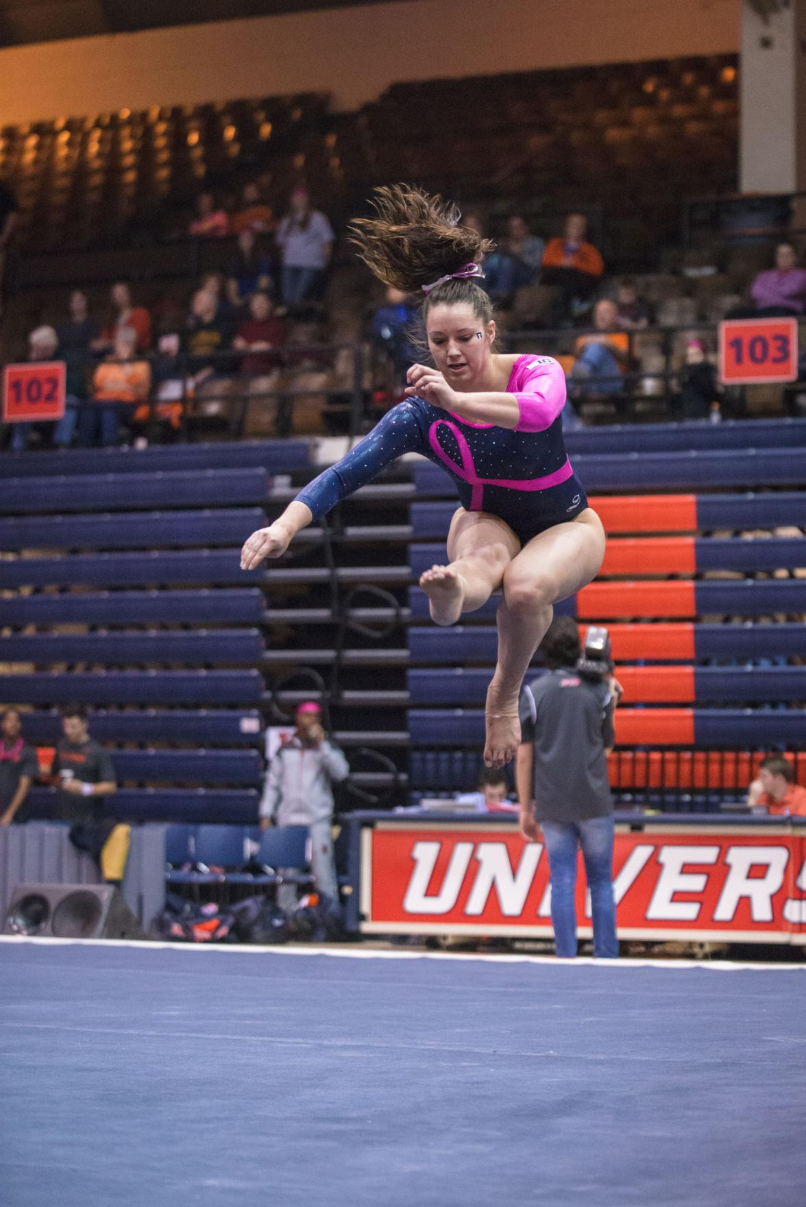 Illinois' Kelsi Eberly performs a routine on the floor during the match against Penn State at Huff Hall on February 1.