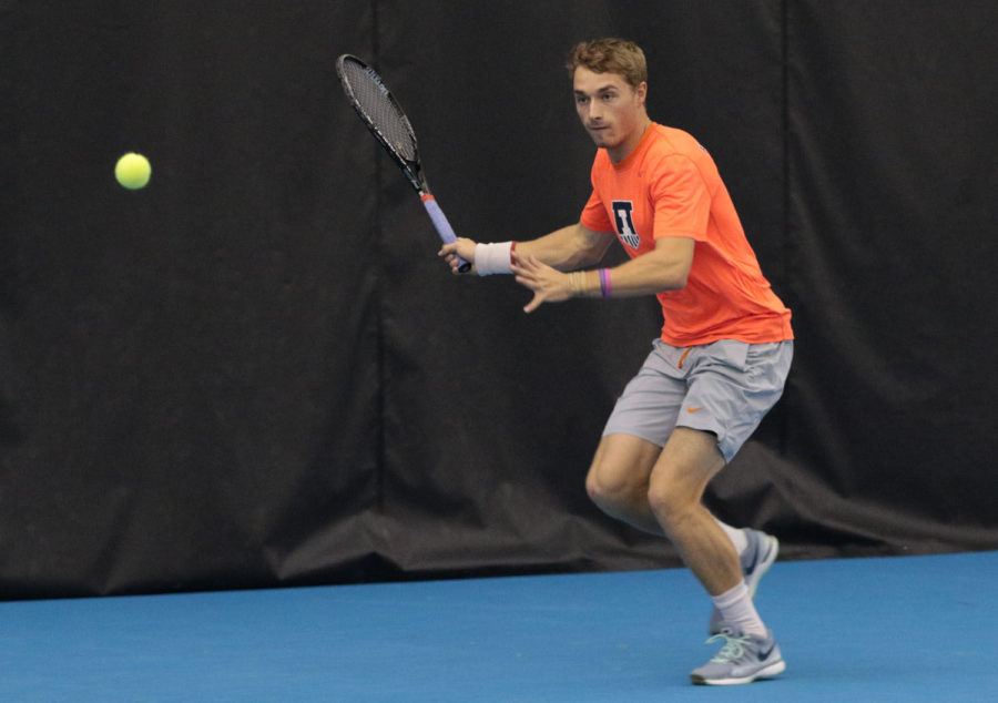 Illinois' Tim Kopinski saves a ball during a match vs. Northwestern on Feb. 20. Kopinski didn't play this weekend because the Illini were trying out new doubles teams.