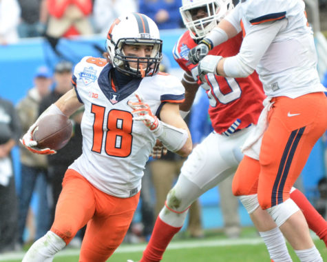 Illinois' Mike Dudek (18) runs the ball during the Zaxby's Heart of Dallas Bowl against Louisiana Tech at Cotton Bowl Stadium in Dallas, Texas on Friday, Dec. 26, 2014. The Illini lost 35-18.
