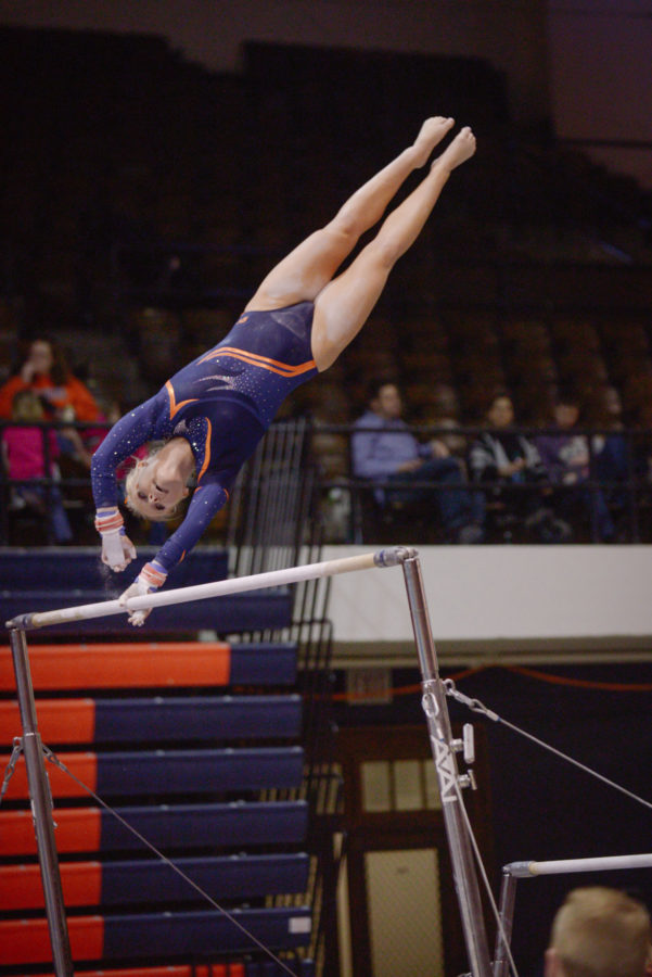 Illinois' Erin Buchanan performs a routine on the uneven parallel bars during the meet against Minnesota at Huff Hall on Feb. 7. The Illini won 195.775-195.375.