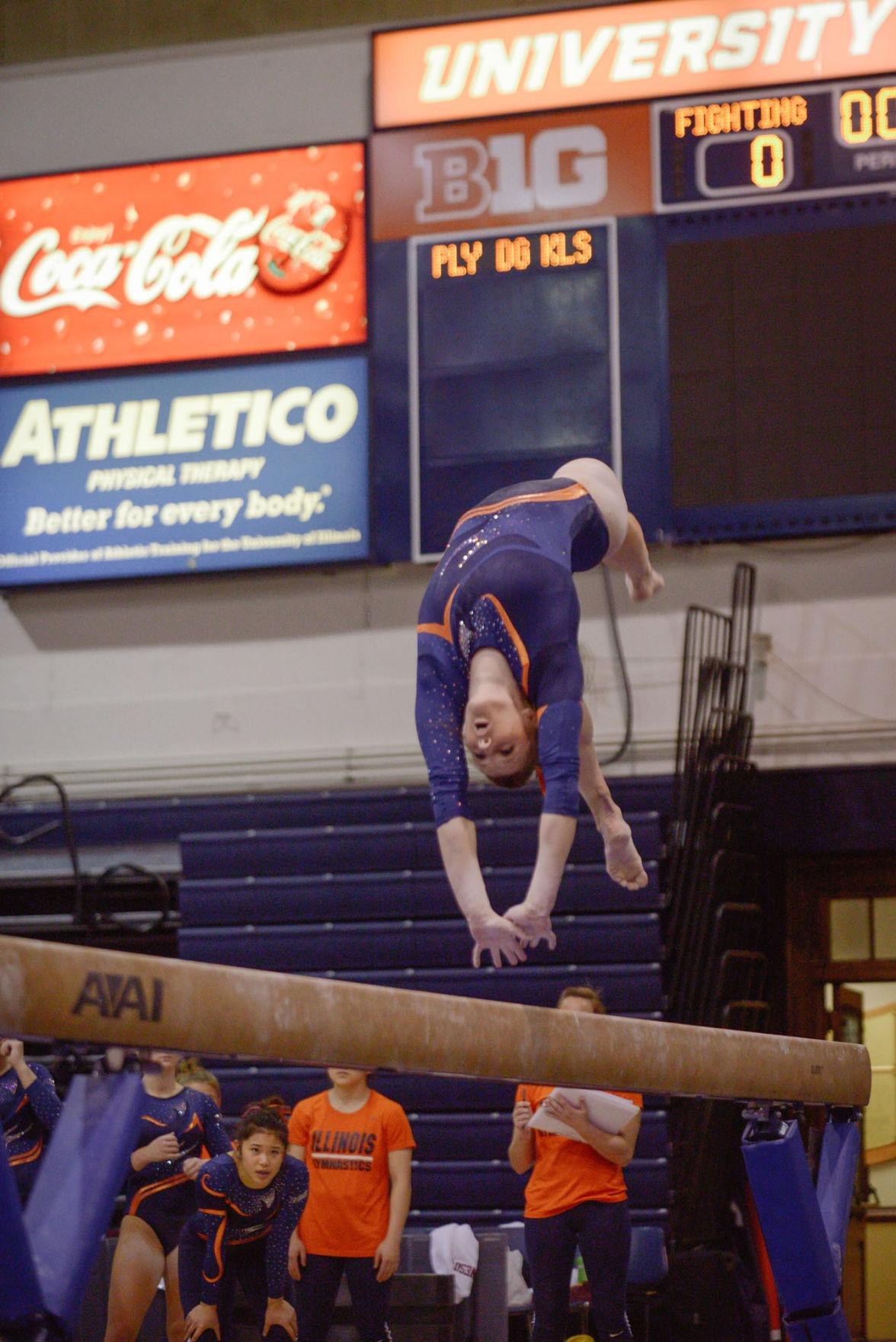 Illinois' Mary Jane Horth performs a routine on the balance beam during the meet against Minnesota at Huff Hall on Saturday. The Illini won 195.775-195.375.
