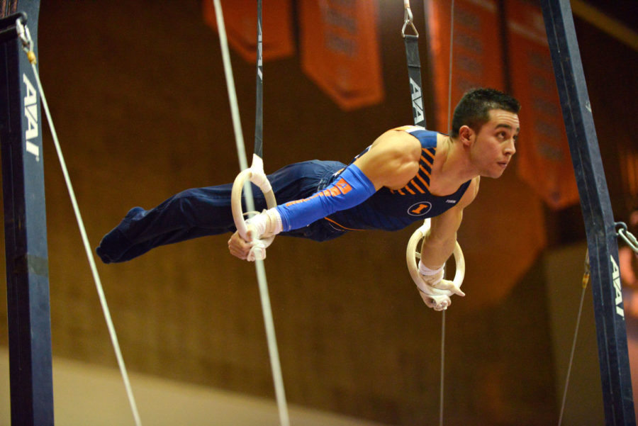 C.J. Maestas performs the rings routine at Huff Hall on Sunday, Jan. 26. Maestas will compete in his final home meet Sunday against Nebraska.