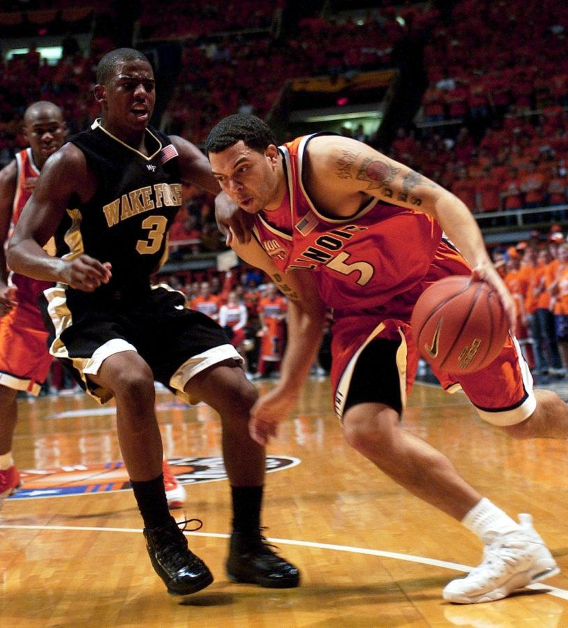 Illinois guard Deron Williams drives to the basket against Wake Forest's Chris Paul.