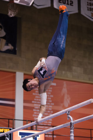 Illinois' Jordan Valdez performs a routine on the parallel bars during the meet against Stanford at Huff Hall on Friday, March 6.The Illini lost 21-9.