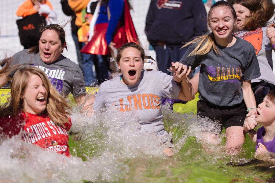 A group of participants simultaneously dive in for the 2015 Polar Plunge to benefit Special Olympics Illinois at Memorial Stadium on Saturday, March 7.