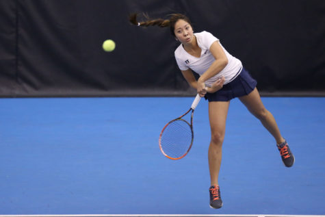 Illinois' Louise Kwong serves the ball during the match against Indiana at Atkins Tennis Center, on March. 1. The Illini won 6-1.