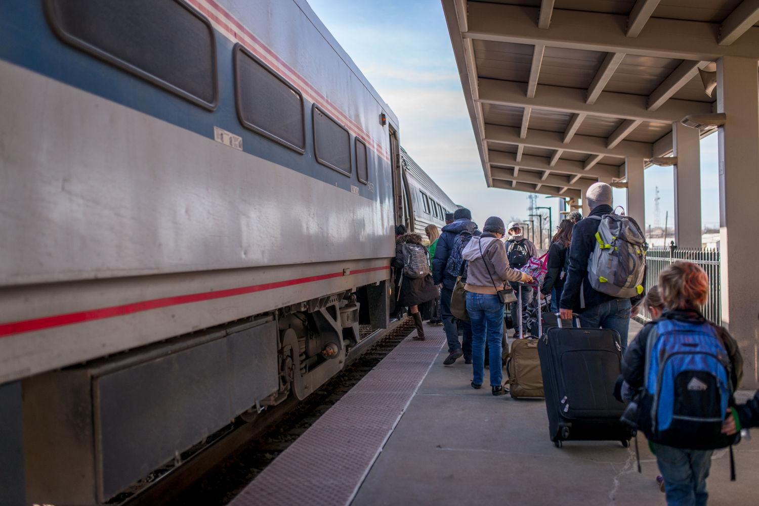Passengers line up to board the Amtrak train at the Illinois Terminal on Tuesday, March 17, 2015.