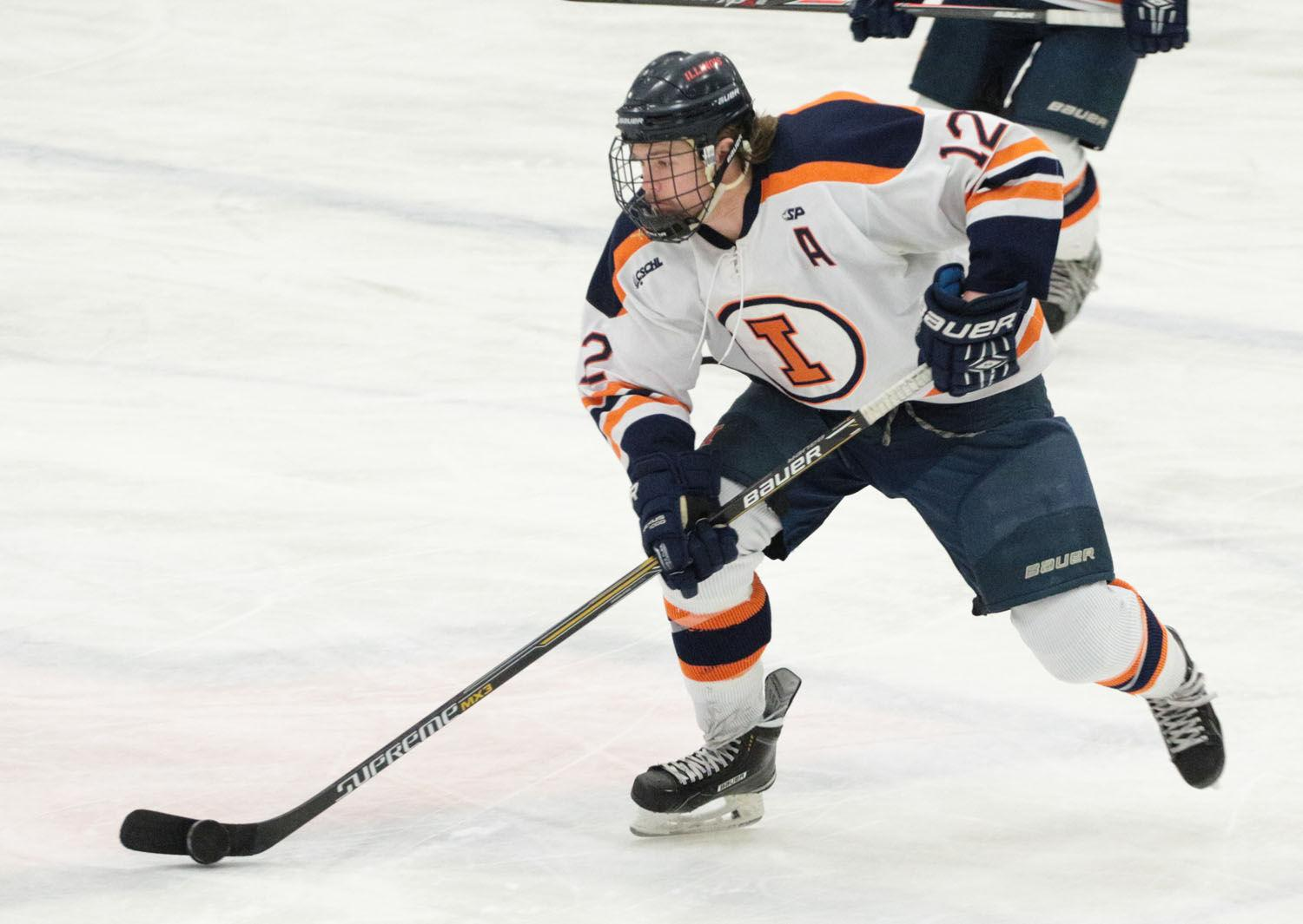Illinois' Jonathan Langan (12) moves the puck down the rink during the hockey game v. Eastern Michigan at the Ice Arena on Friday. Illinois won 10-1.