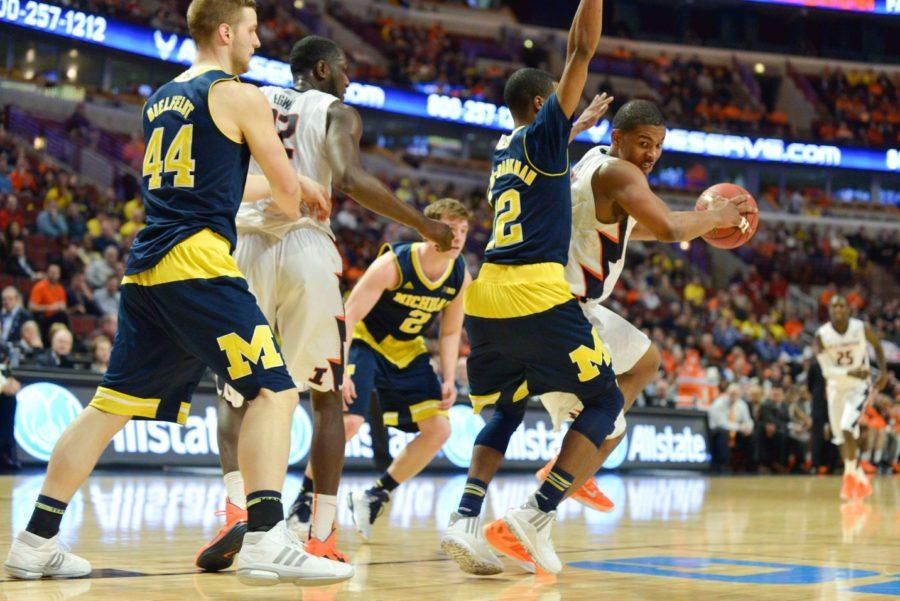 Illinois' Malcolm Hill (21) attempts to get past Michigan's defense during the game at United Center in Chicago, Illinois during the Big Ten Tournament on Thursday, March 12, 2015. The Illini lost 73-55.