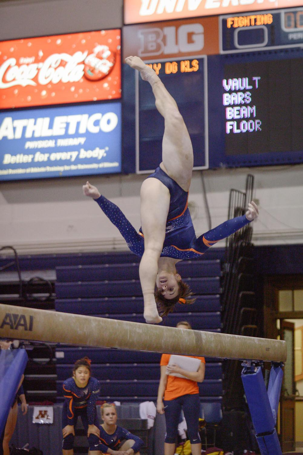Illinois' Giana O'Connor performs a routine on the balance beam during the meet against Minnesota at Huff Hall on Saturday, February 7, 2015. The Illini won 195.775-195.375. O'Connor won the bars event title on Saturday with a score of 9.900.