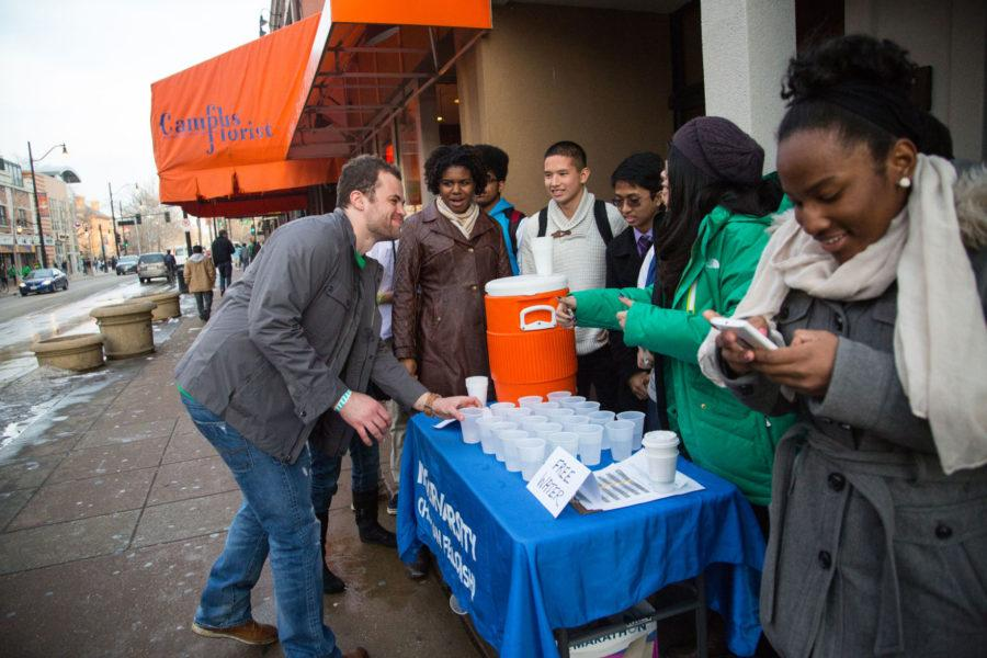 Members+of+Intervarsity+Christian+Fellowship+hand+out+cups+of+water+on+Green+Street+during+Unofficial+St.+Patricks+Day.