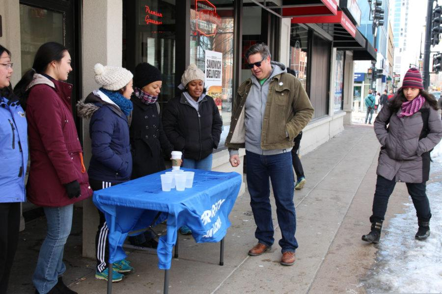 Don Gerard, Champaign's mayor and liquor commissioner, walks the streets of Campustown on Unofficial visiting bars to check in with owners and employees. This was Gerard's fourth Unofficial as Champaign's mayor, but despite hesitations by community members, he has learned to embrace the holiday — not eliminate it.