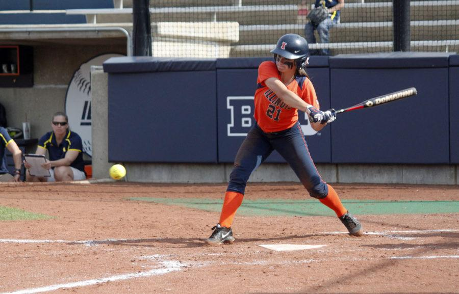 Illinois' Allie Bauch (21) hits a foul ball during the second game against Michigan at Eichelberger Field on Saturday April 26. The Illini lost 6-5.