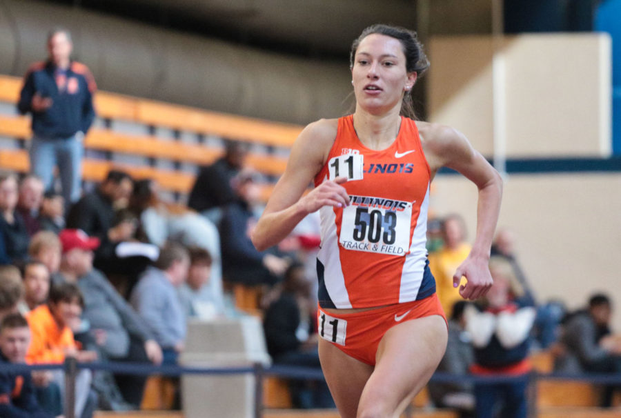 Illinois' Hanna Winter (503) runs for the finish line during the 1 Mile Run event at the Orange & Blue meet at the Armory on Saturday, Feb. 21. Illinois' women's team won 1st place out of 5.
